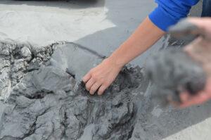 Kids discover fine, sticky, glacial silt mud at Alaska's Matanuska Glacier